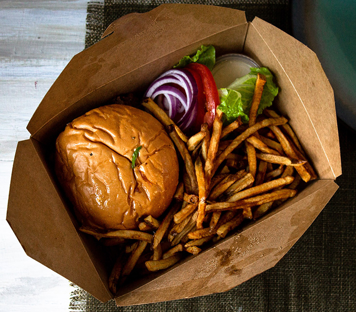 Takeout container with burger